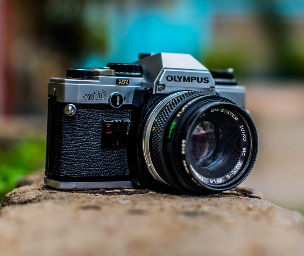 macro shot of black Olympus camera