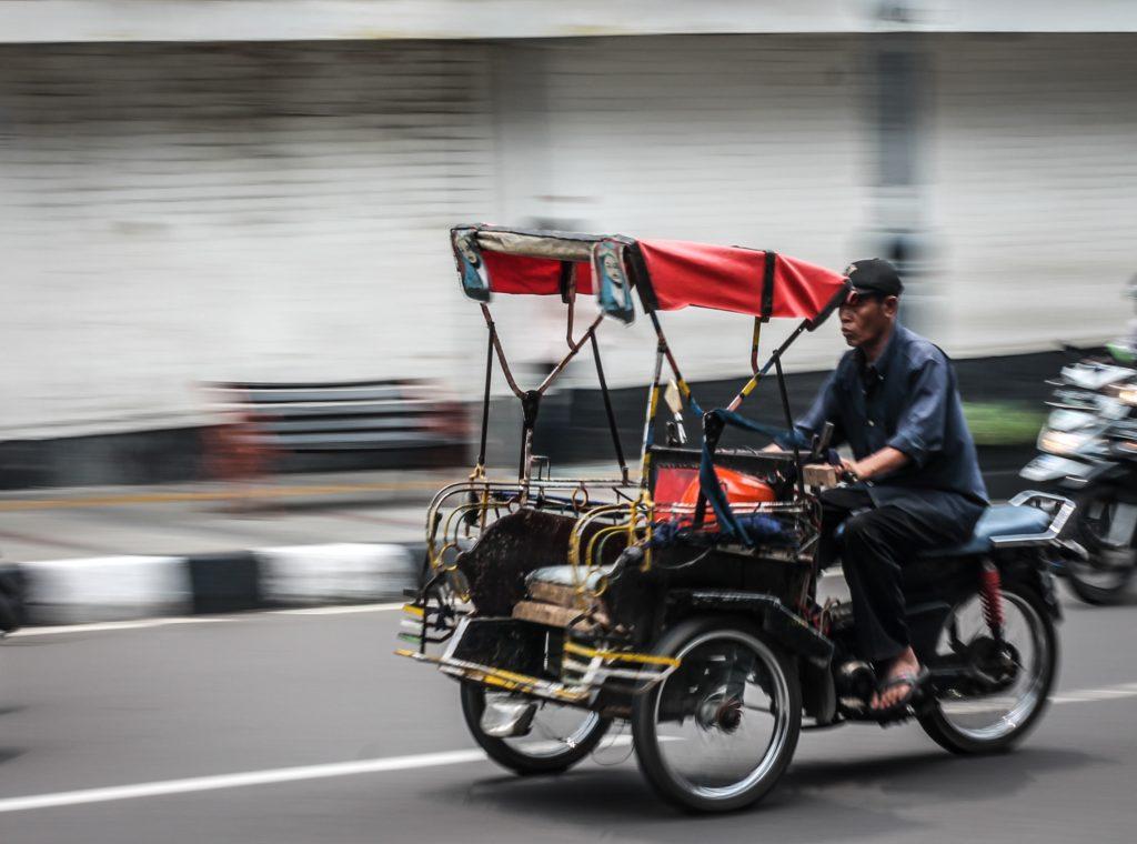 Speeding rickshaw with motion blur