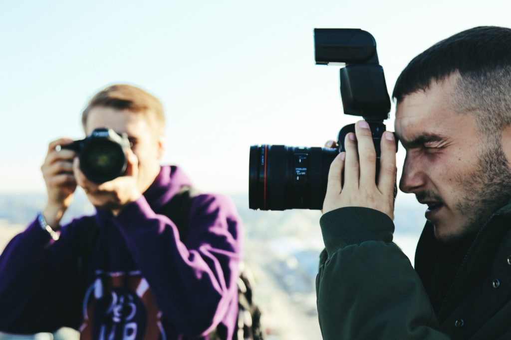Two photographers shoot in harsh light