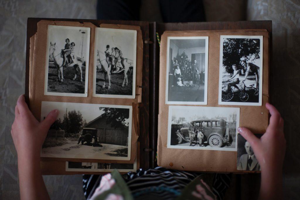 Photo album of old black and white prints