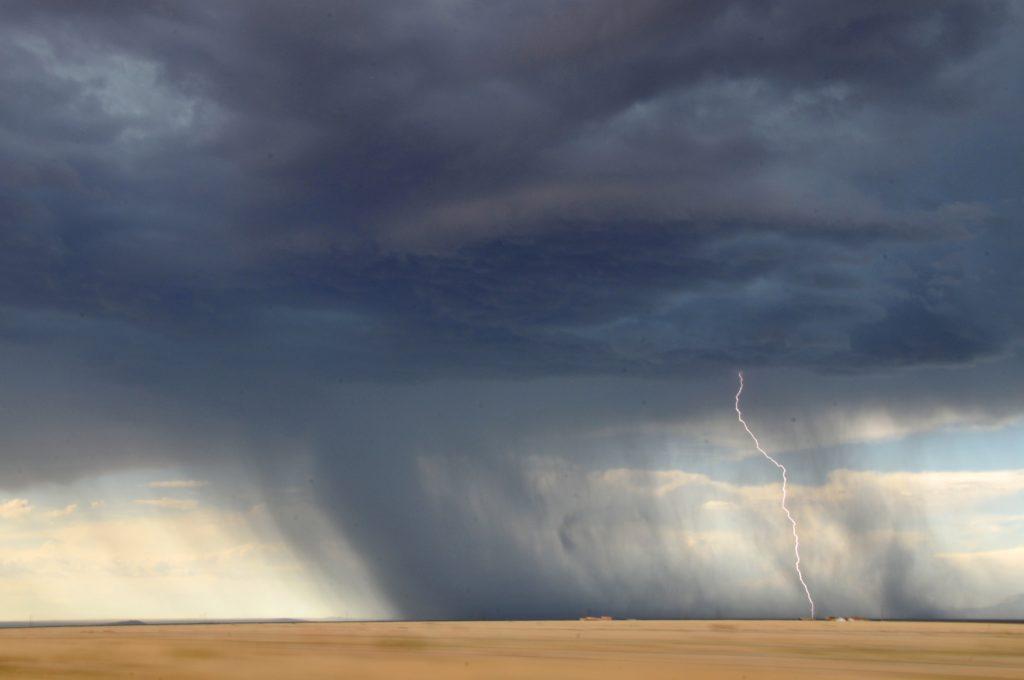 Desert storm with lightning.