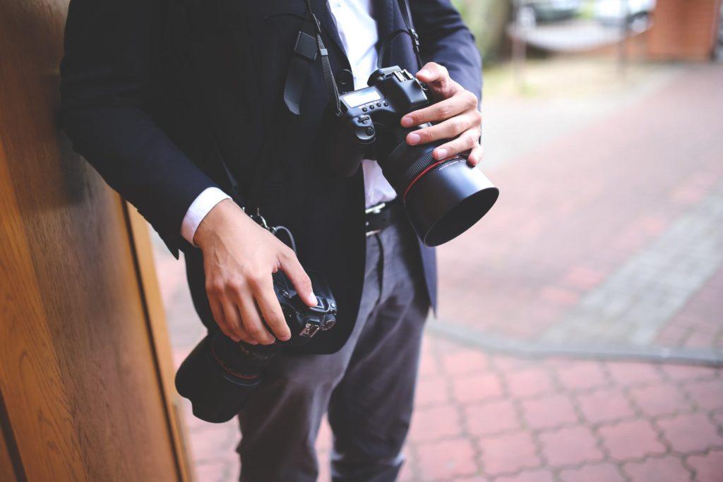 man hands photographer cameras