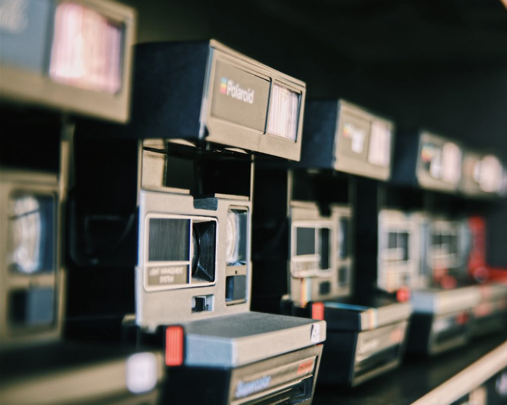 A line of old Polaroid Land cameras