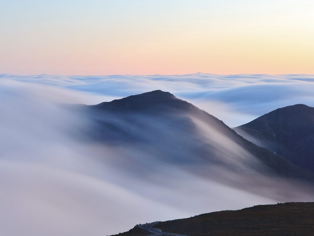 black mountains under white clouds during daytime