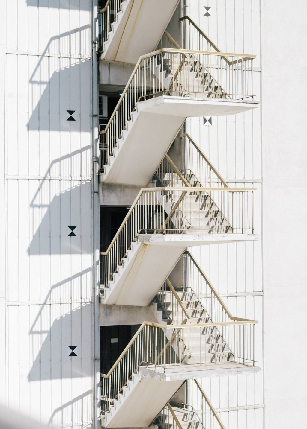 modern staircase of white building in sunlight