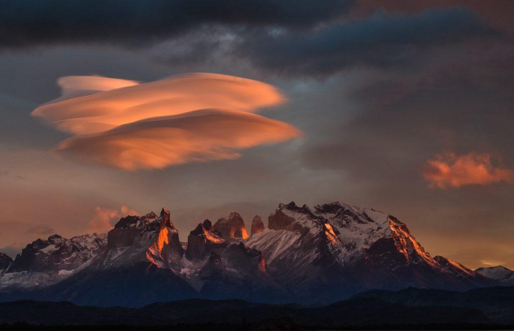 rocky mountain under orange sky