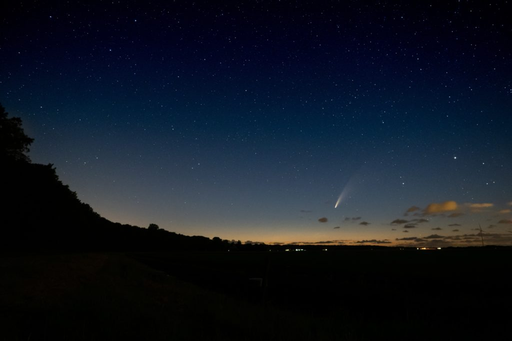 Comet in front of silhouette foreground
