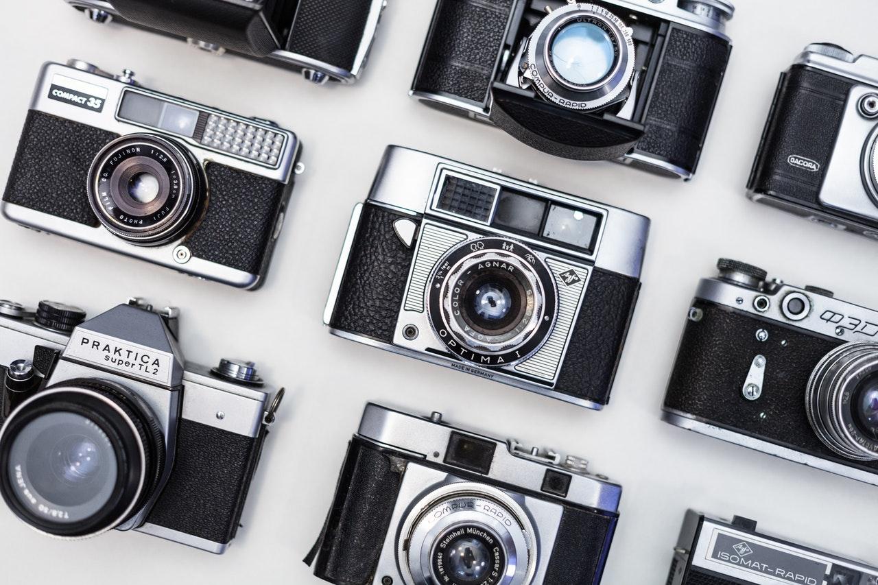 nine gray and black land cameras