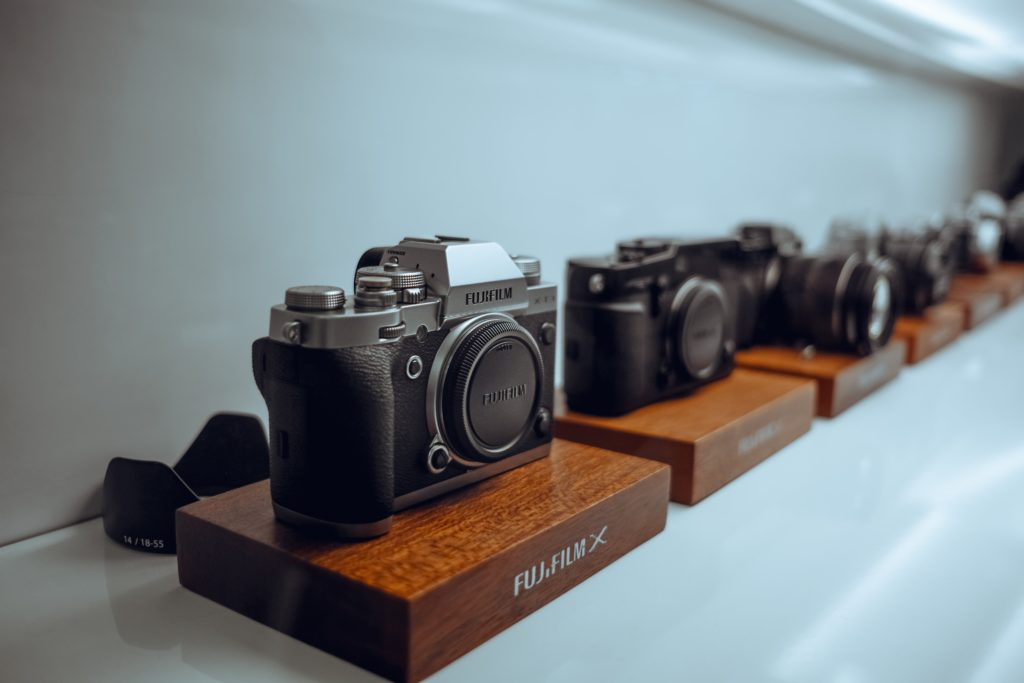 Line of Fuji cameras on shelf