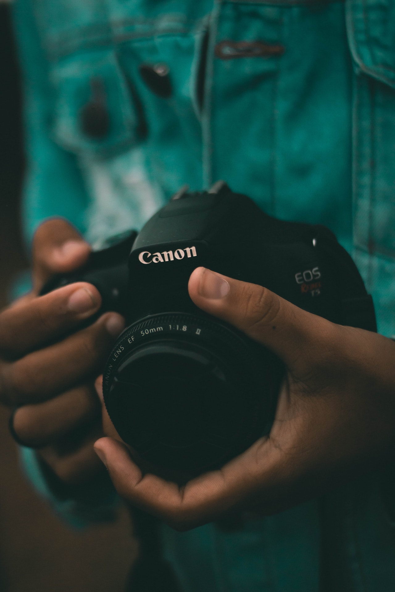 person holding black canon dslr camera