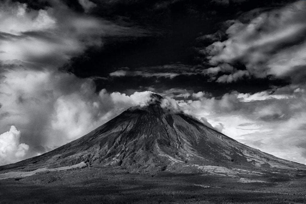 Dark sky over mountain in black and white