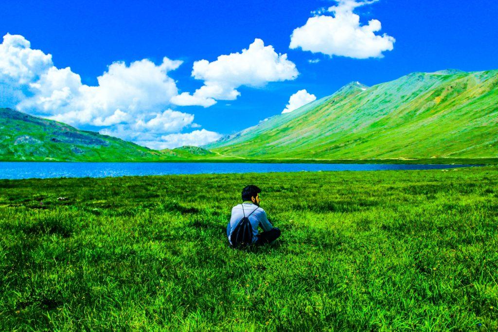 Garish HDR image of boy in landscape