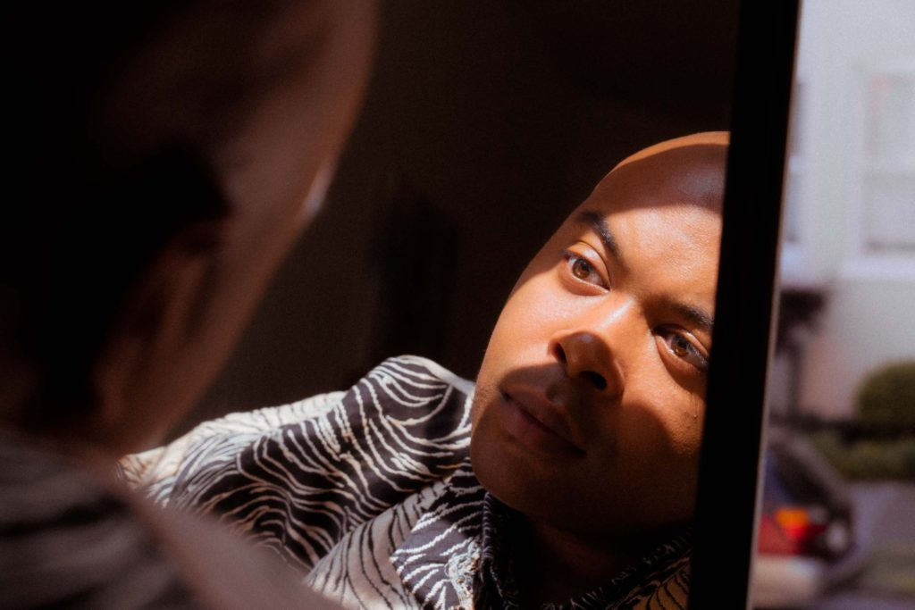 Dutch Angle portrait of man with reflection in the mirror