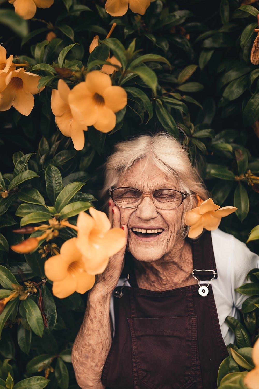 Lady in flowers happy
