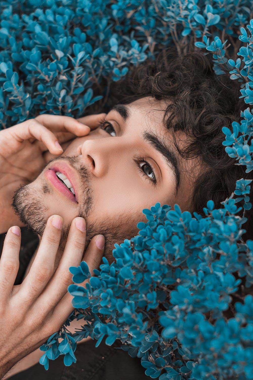 Man's head in bush