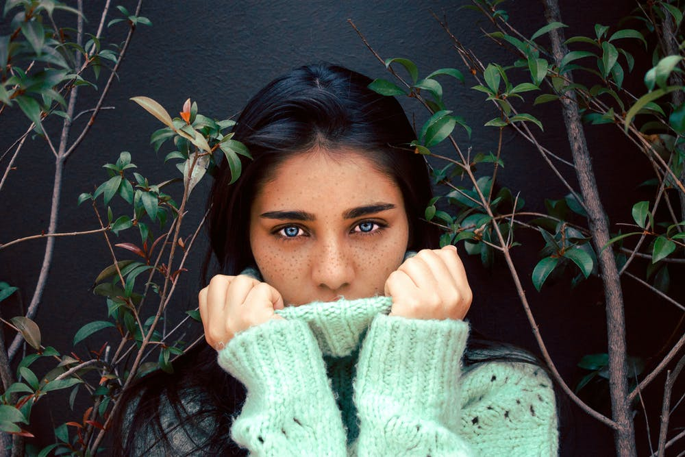 Girl between branches