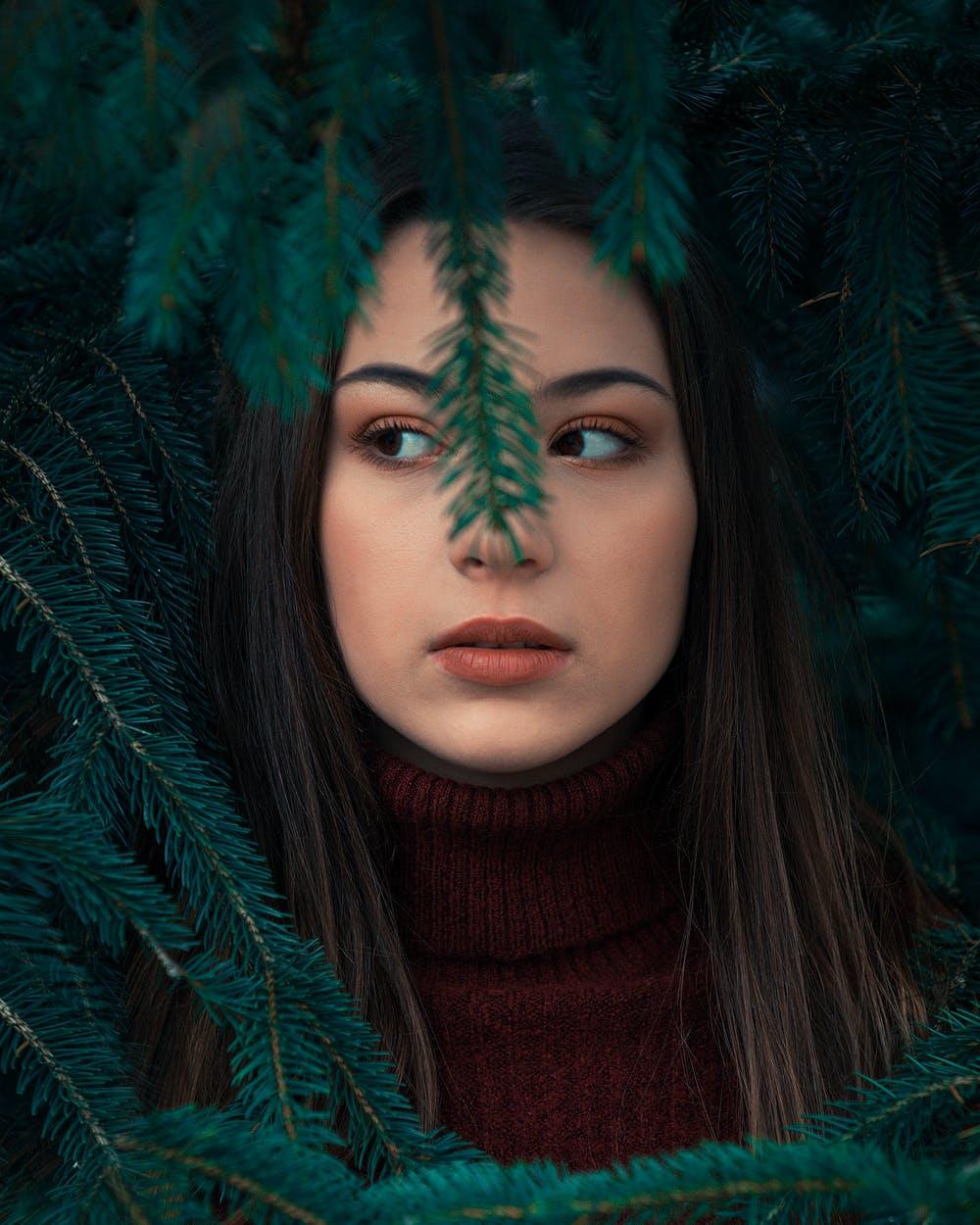 Girl behind branch