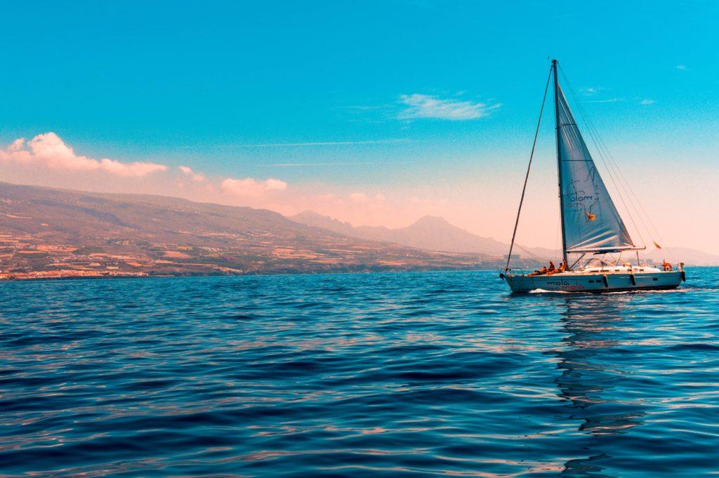 Yacht sailing on a tilted horizon