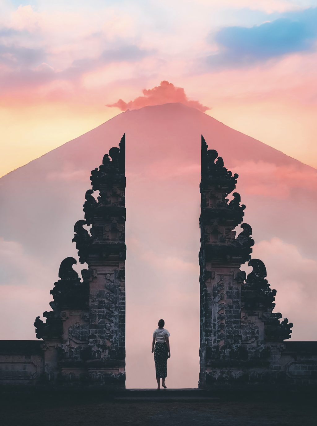 photo of person standing on temple