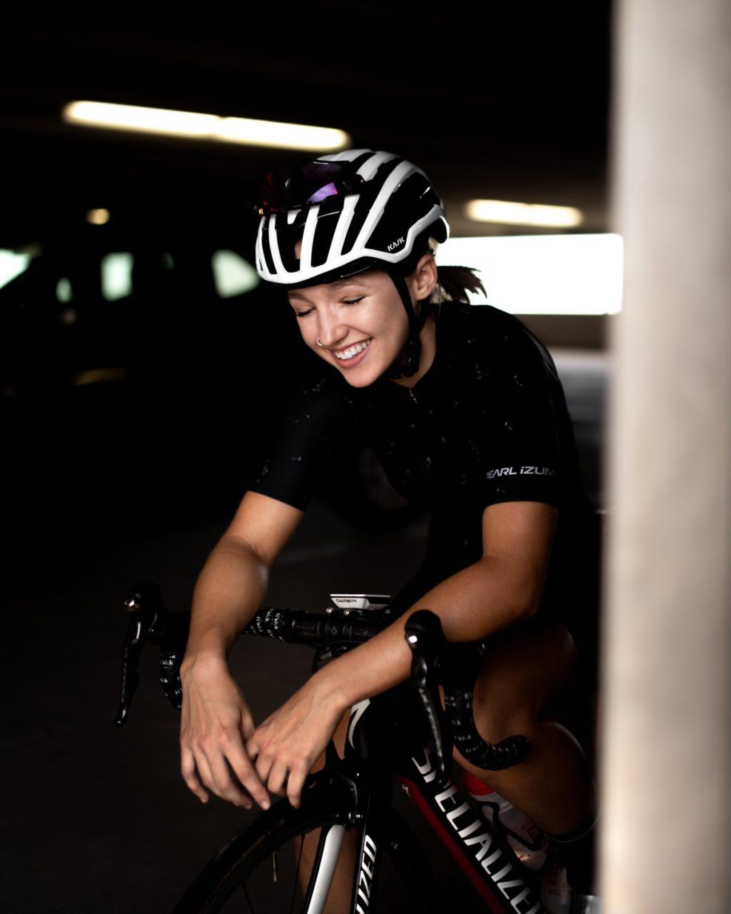 photo of woman riding bike