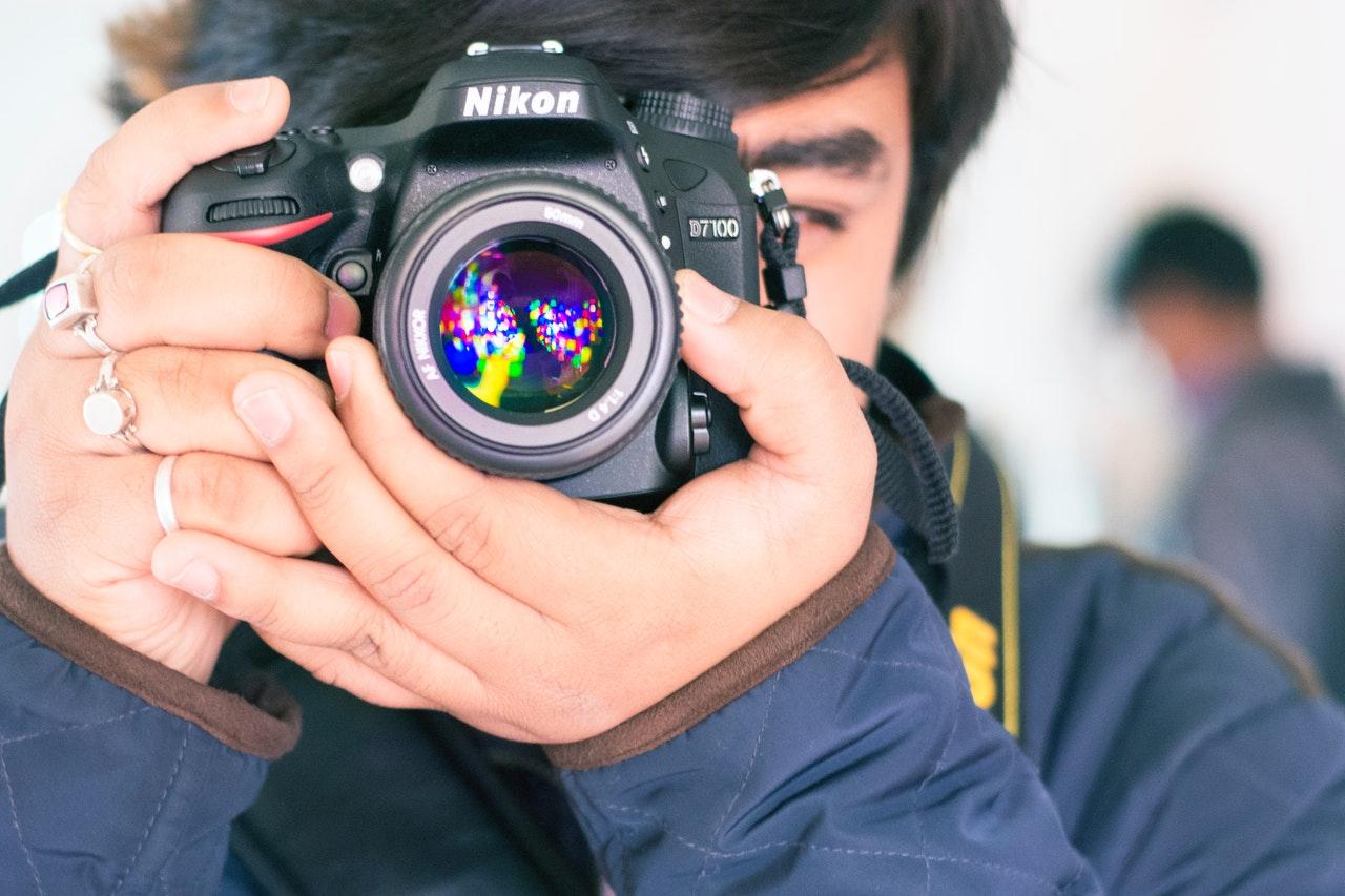photographer taking photo photography nikon