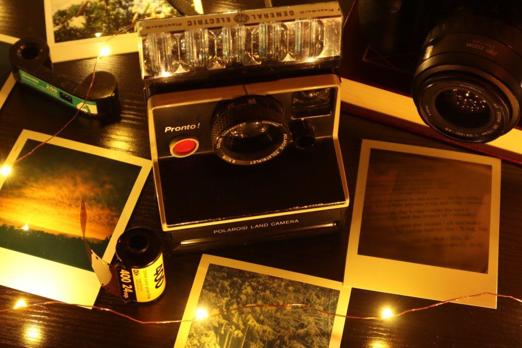 Vintage Polaroid camera and prints.