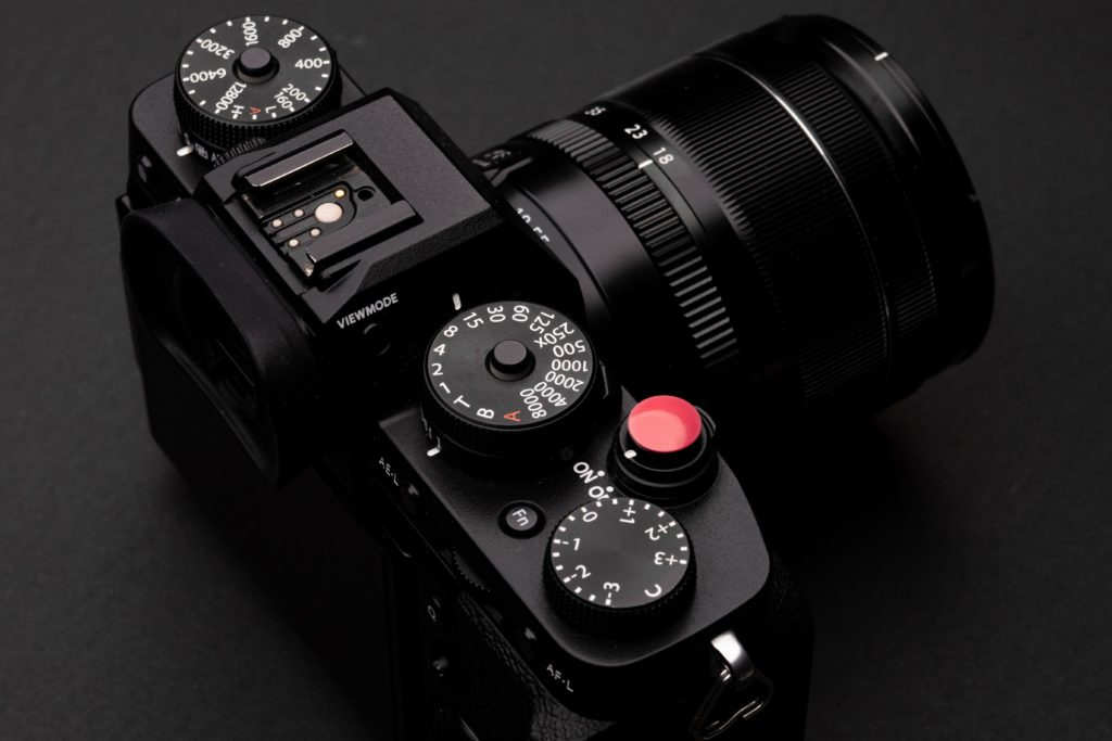 Top plate of digital camera with exposure compensation dial