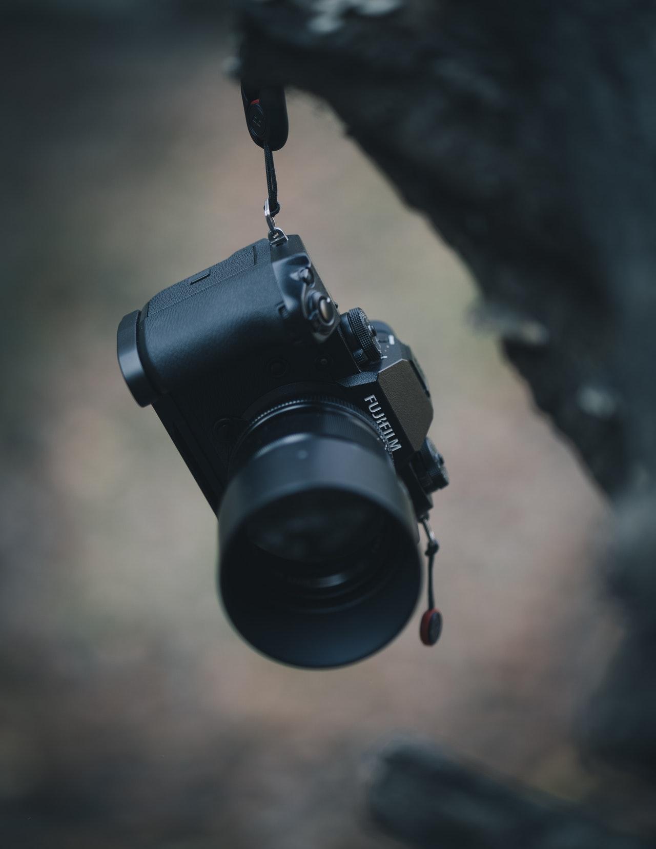 selective focus photography of fujifilm camera
