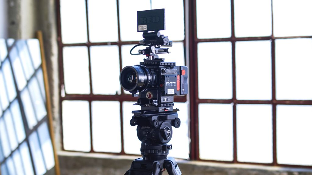 video camera on video tripod