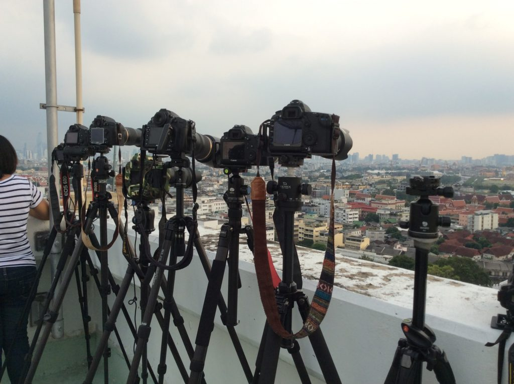 Row of tripods with cameras