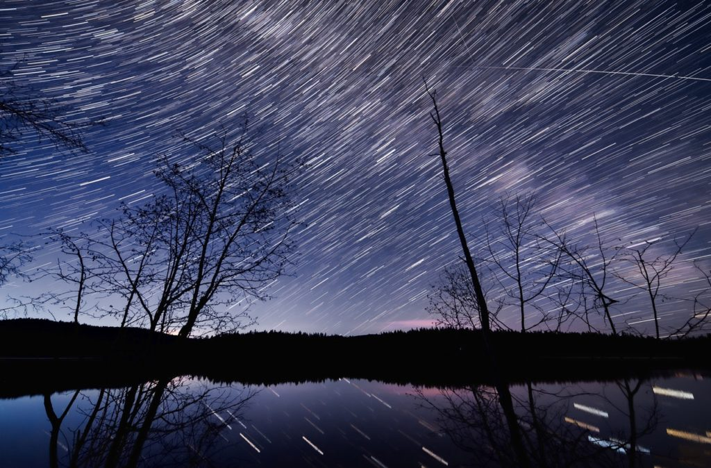 time lapse photography of body of water at nighttime