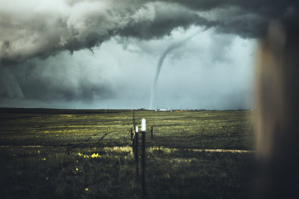 tornado on far side on plain