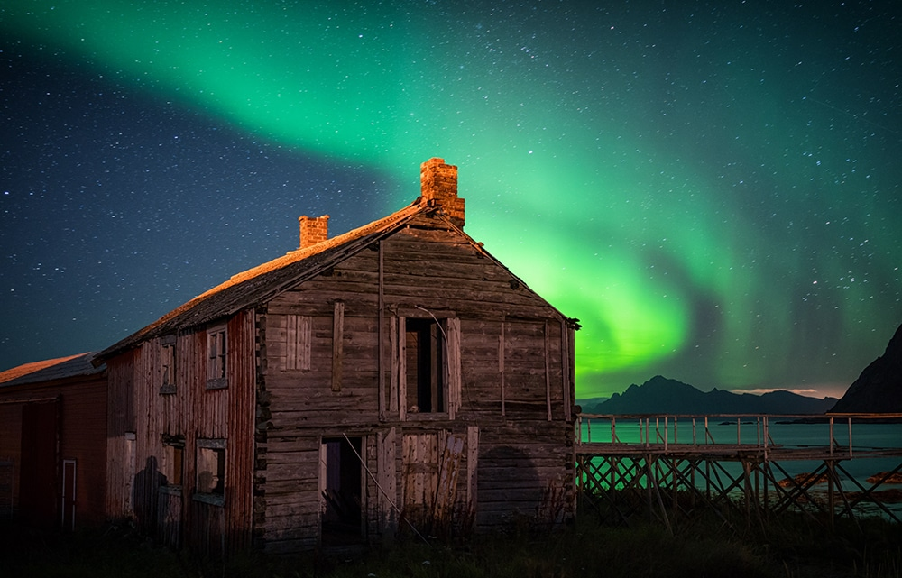 the aurora over an old shack