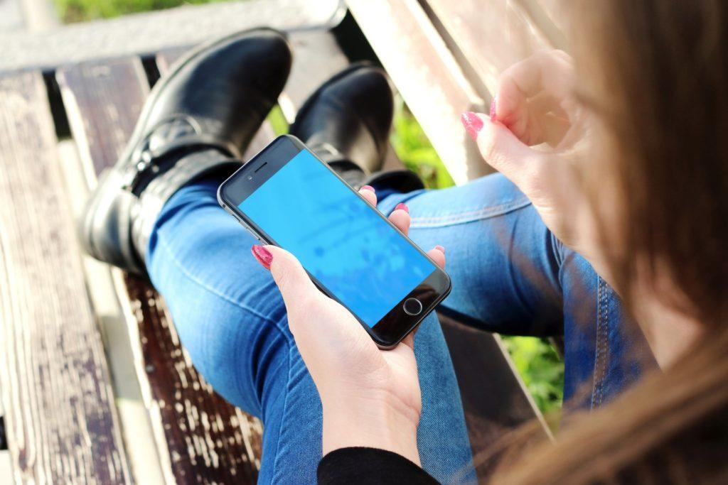 woman hand apple iphone